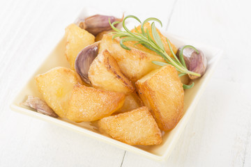 Roast Potatoes - White potatoes roasted with garlic and rosemary