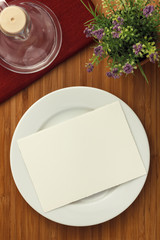 white plate and flower on wood table