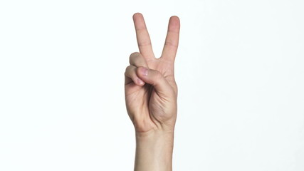 man's hand showing victory sign