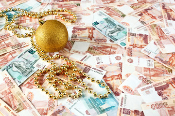 Christmas ball on russian money background