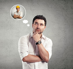 Young man thinking of room repair and professional constructor