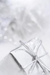 Silver gift box on white blur background