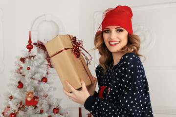 beautiful woman gives a gift i Christmas