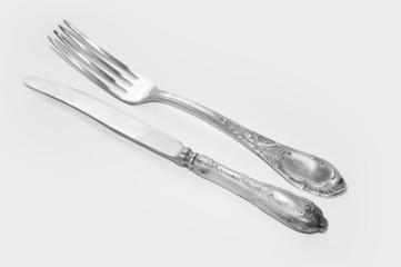Vintage cutlery on white