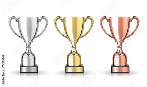 golden,silver and bronze trophies isolated on white background - 74599243