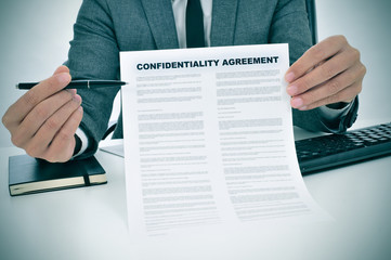 young man showing a confidentiality agreement document