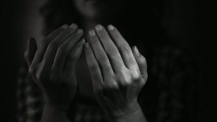 Muslim woman praying to god. Black and White