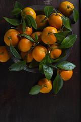 Tangerines on a dark background