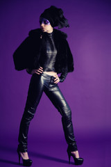 young fashion model in the studio on a purple background