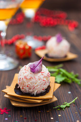 appetizer of crab-cheese balls on the festive table