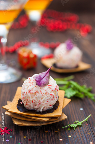 Fotobehang Salade appetizer of crab-cheese balls on the festive table