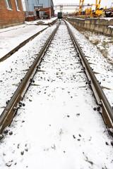 railroad in industrial area in winter