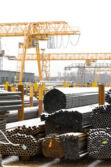 storing of metal pipes in outdoor warehouse