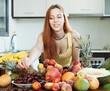 girl with many ripe fruits