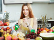 woman cooking fruit salad with cream