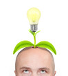 Businessman with new idea growing from his head.