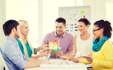 smiling interior designers working in office