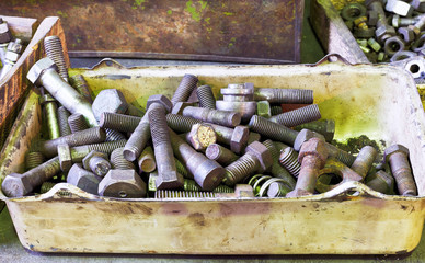many old bolts on workbench in turnery