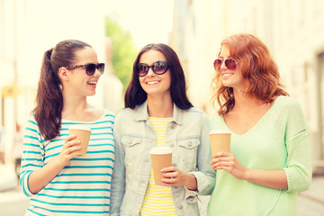 smiling teenage girls with on street