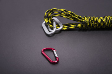 Mountaineers' carabiner with climbers rope