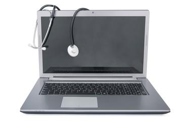 Stethoscope draped on laptop