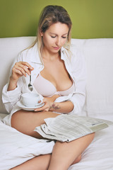 Beautiful woman reading newspaper