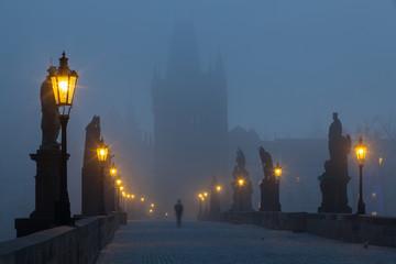 On the famous Charles Bridge in the morning mist, Prague, Czech
