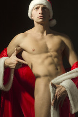 handsome Santa in erotic pose with a beautiful naked body