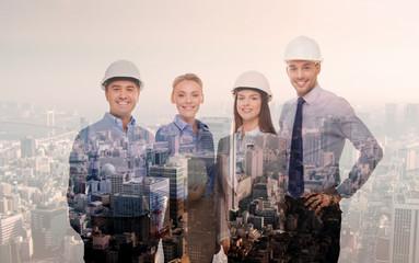 happy businessmen in helmets over city background