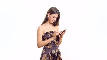 young beautiful woman says on your smartphone and smiling