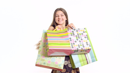 Young happy girl with shopping bag on the white background.