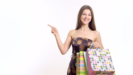Young happy girl with shopping bag on the white background.Young