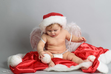little boy with Santa and angel costume