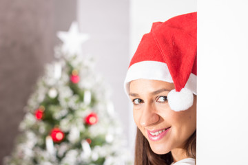 Beautiful woman with Santa hat posing
