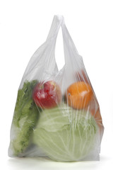 Clear plastic grocery bag isolated on white