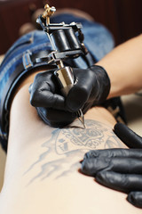 Guy doing tattoo
