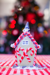 Gingerbread fairy house decorated with colorful candies of
