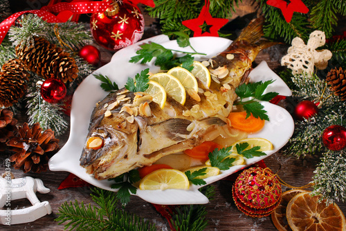 roasted carp stuffed with vegetables for christmas - 74613419