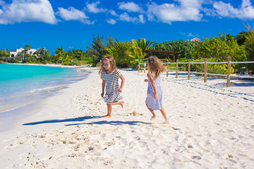 Adorable little girls during summer beach vacation