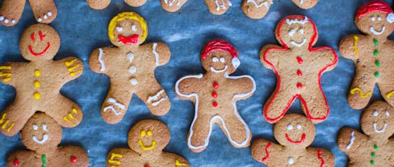 Colorful gingerbread men on baking sheet for Christmas time