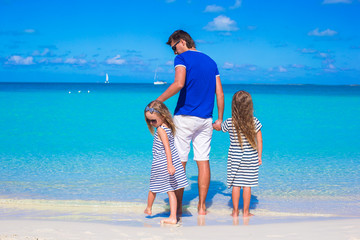 Father and little cute girls during tropical vacation