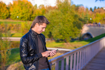 Young man with a phone in the park