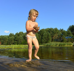 Little girl in water on sunny day