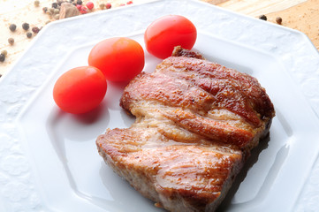 pork steak with cherry tomatos