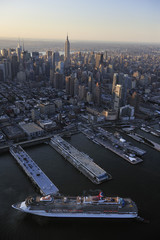Cruise ship with Manhattan skyline along Hudson river, New York