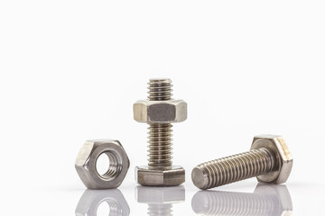 Metal screw and nuts on white background.