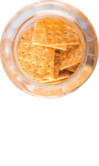 Sugar crackers or biscuits in a cookie jar over white background