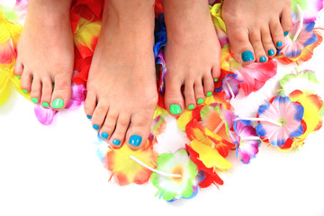 women feet (pedicure)  with flowers