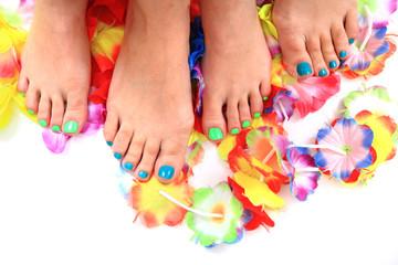 women feet (pedicure)  with flowers