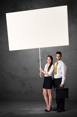 Business couple with blank whiteboard